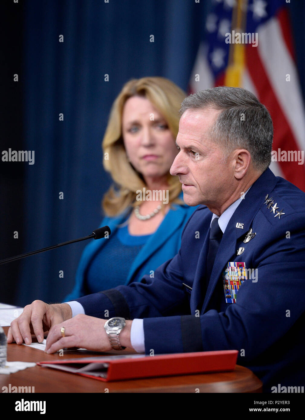 Air Force Chief of Staff Gen. David Goldfein, with Secretary of the Air Force Deborah Lee James, answers a question during the 'State of the Air Force' press conference, in the Pentagon, Aug. 10, 2016.  Goldfein stated, 'Airpower has become the oxygen the joint force breathes.  Have it and you don't even think about it.  Don't have it . . . and it is all you think about.'  (U.S. Air Force photo/Scott M. Ash) - Stock Image