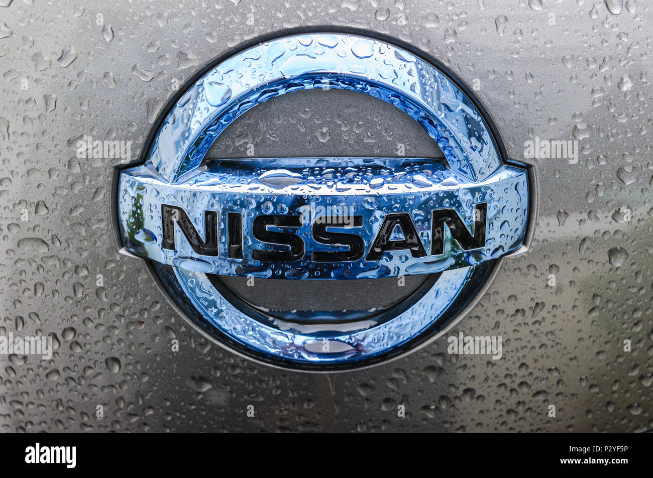 Nissan Badge On The Front Of A Nissan Leaf Stock Photo Alamy