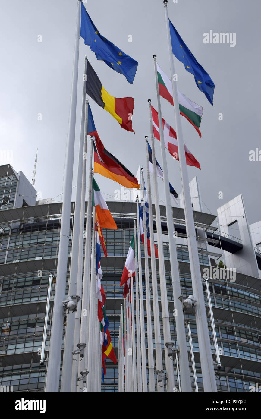 STRASBOURG, BR, FRANCE - JUNE 13, 2018: Flags of the EU members waving in front of the European Parliament in Strasbourg - Stock Image