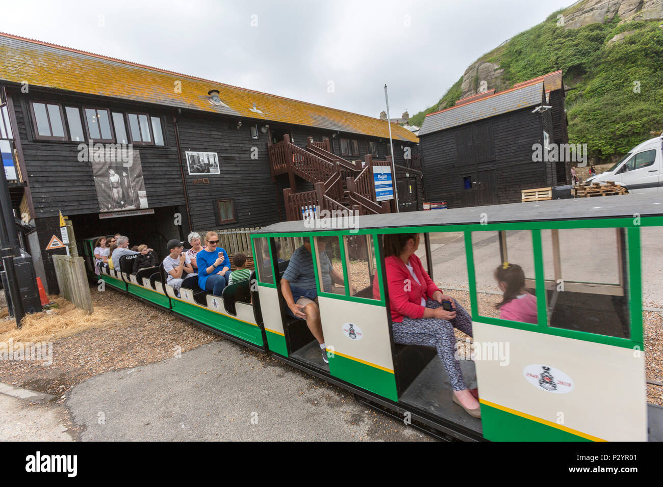 Passengers in Hastings Miniature InterCity Railway. Hastings, East Sussex, England , UK - Stock Image