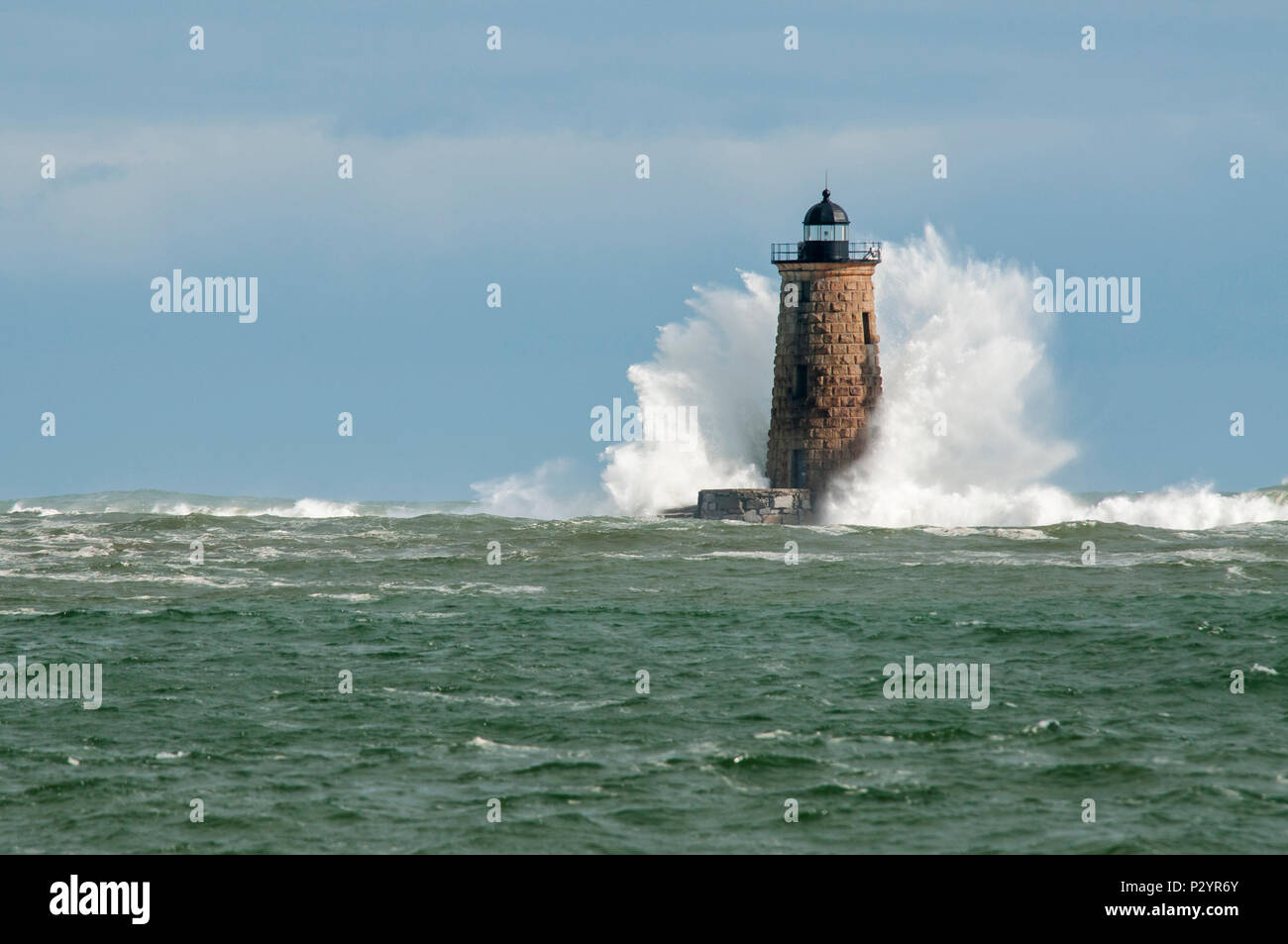 Giant waves cover the stone tower of Whaleback lighthouse in southern Maine during an astronomically high tide. - Stock Image