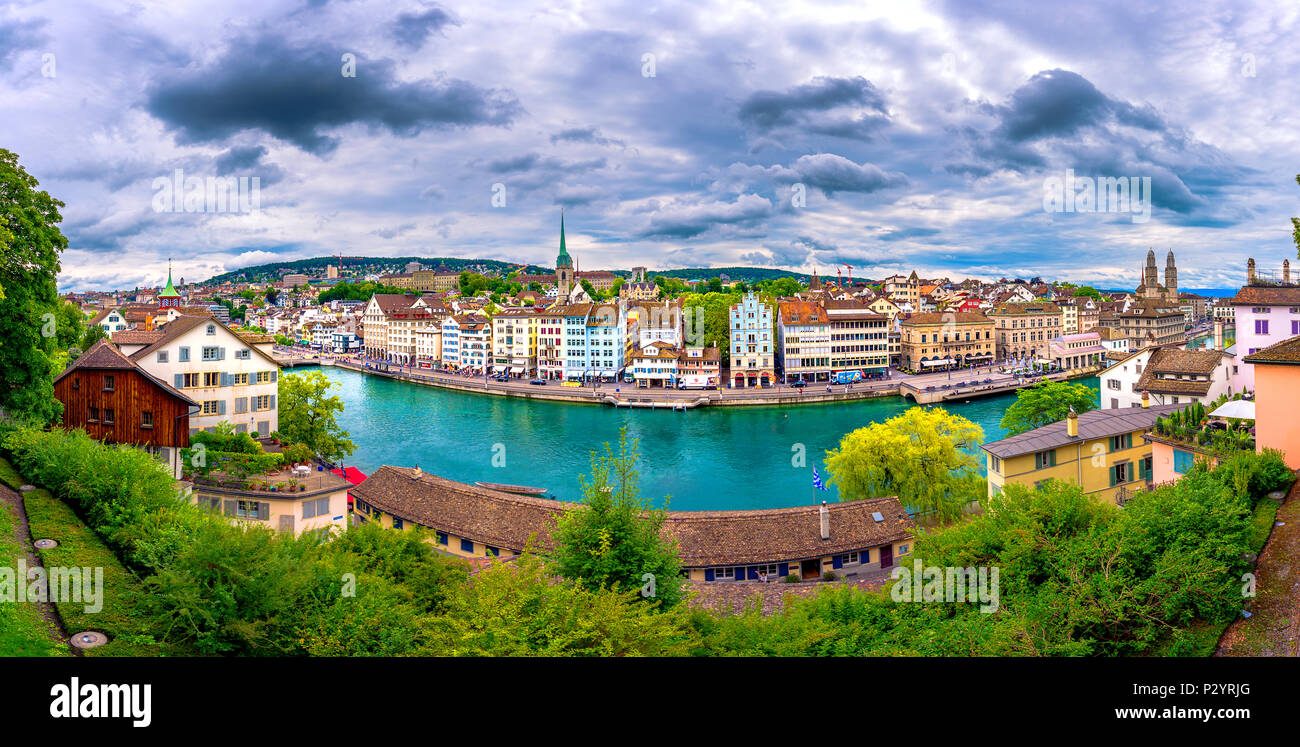 Panoramic view of historic Zurich city center with famous Fraumunster, Grossmunster and St. Peter and river Limmat at Lake Zurich, Switzerland - Stock Image