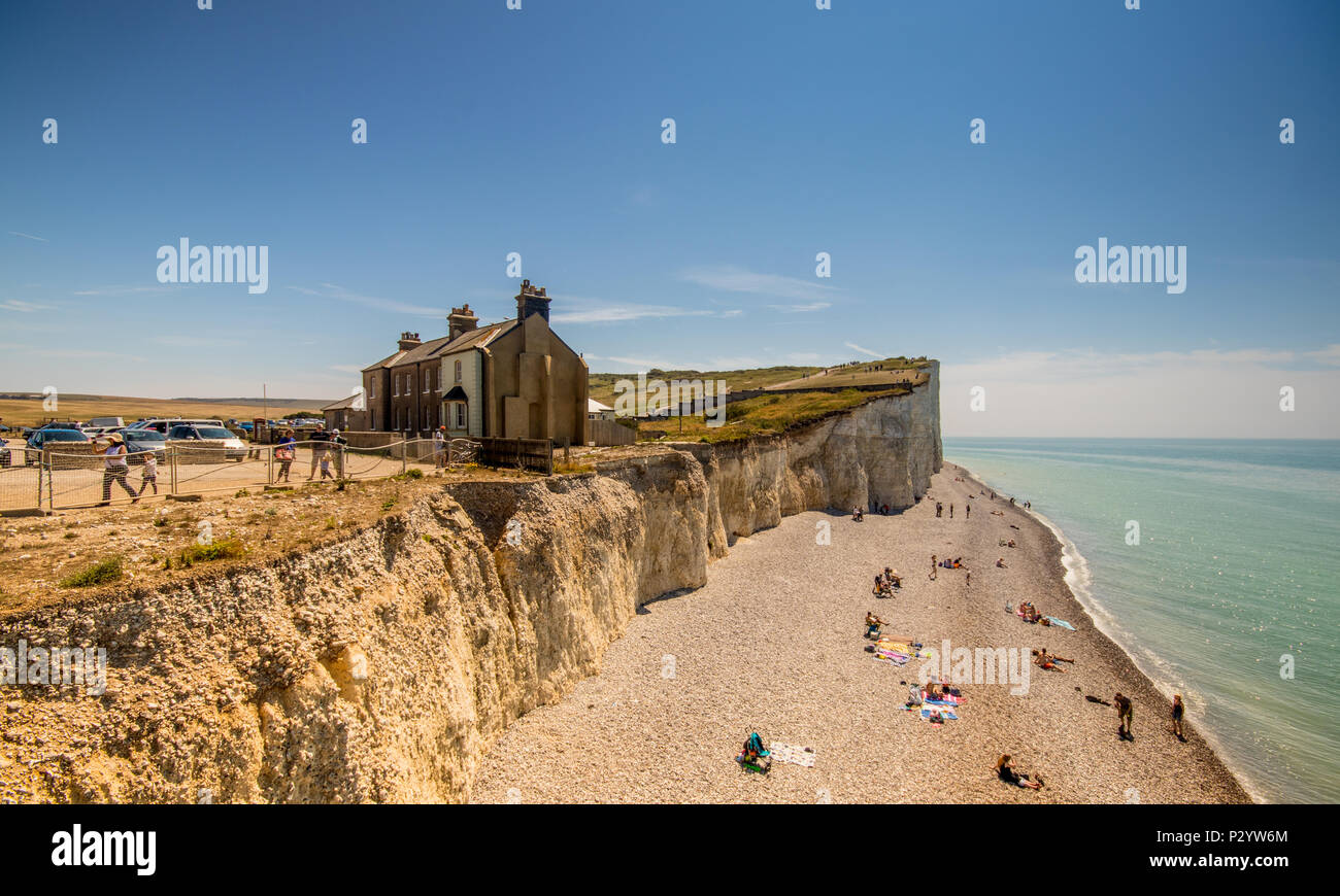 Houses near the cliff edge at Birling Gap, Seven Sisters Country Park near Eastbourne, East Sussex, UK - Stock Image