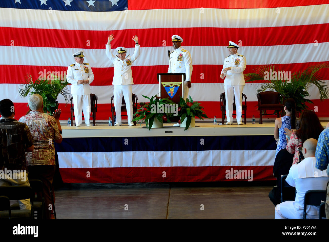 160812-N-SS432-053  BARKING SANDS, Hawaii (Aug. 12, 2016) Capt. Bruce Hay acknowledges the audience as they give him a big aloha welcome during Pacific Missile Range Facility's change of command ceremony. Hay is being relieved as commanding officer by Capt. Vincent Johnson. (U.S. Navy photo by Mass Communication Specialist 2nd Class Omar Powell/Released) Stock Photo