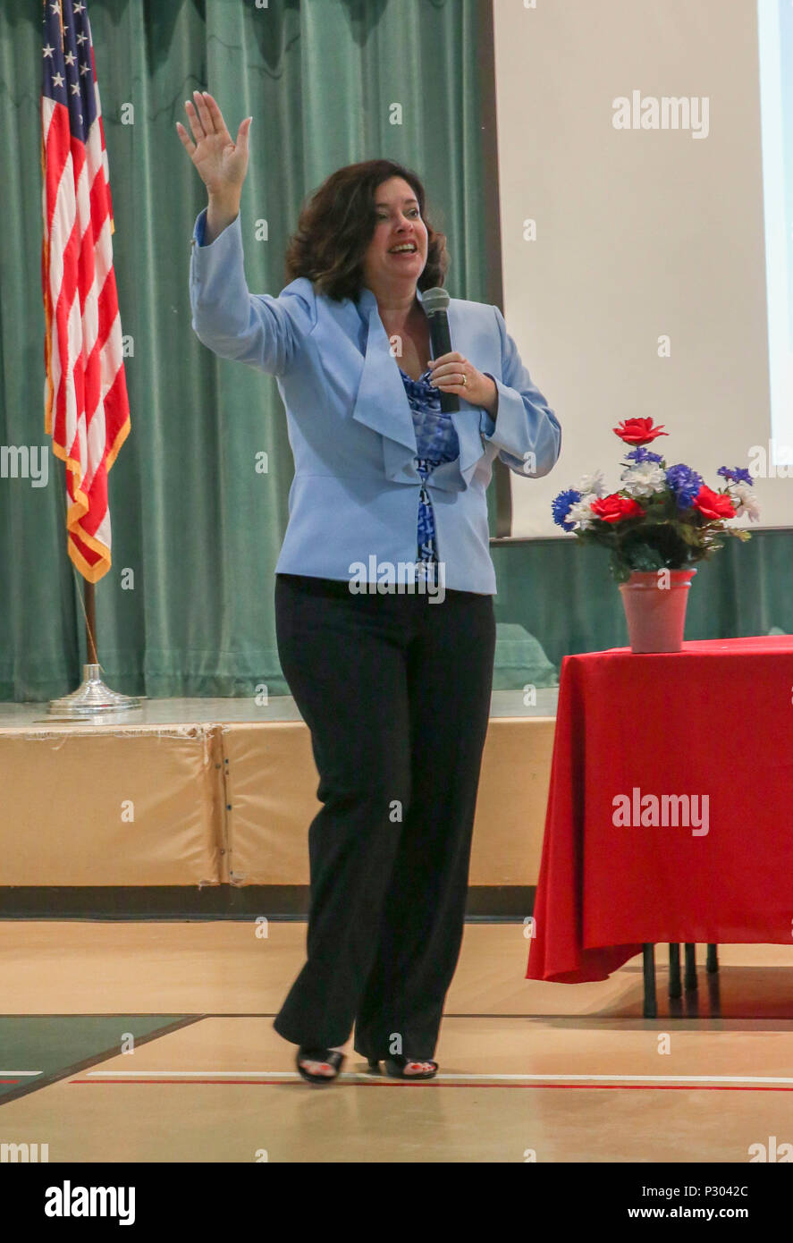 """Dr. Christy Huddleston delivers a speech at the Laurel Bay Communities opening  ceremony at Bolden Elementary/Middle School Aug. 11. To illustrate how much  teaching has changed she took a poll of the audience. The theme of the opening was  """"embracing change;changes that have been made will create a better atmosphere  of colaboration and teamwork. Huddleston is Department of Defense Education  Activities Americas Southeast District Superintendent. Stock Photo"""