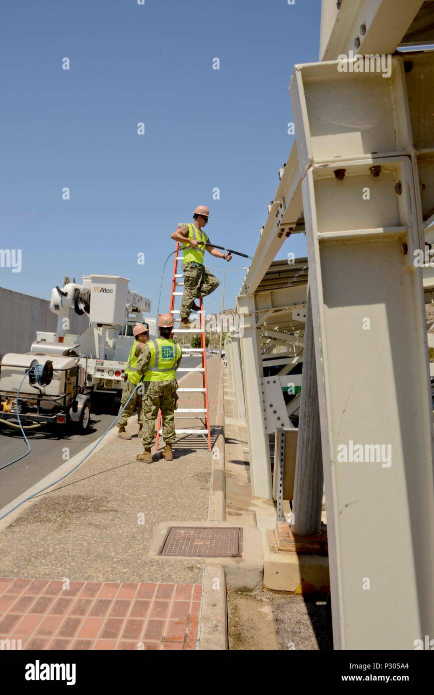 160818-N-IL474-104  SOUDA BAY, Greece (Aug. 18, 2016) Seabees from Naval Facilities Engineering Command (NAVFAC), Europe Africa Southwest Asia Public Works Department, Souda Bay, Greece, perform routine maintenance on solar panels.  Naval Support Activity (NSA) Souda Bay contributes to the Navy's Great Green Fleet initiative by using solar panels to offset local utility costs. (U.S. Navy photo by Heather Judkins/released). - Stock Image