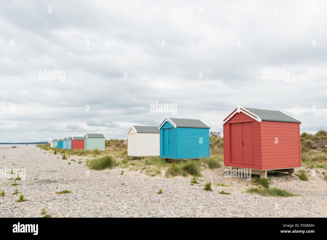 Beach Huts on Scottish beach, at Burghead Bay near Findhorn, Moray Firth, Scotland, UK - Stock Image