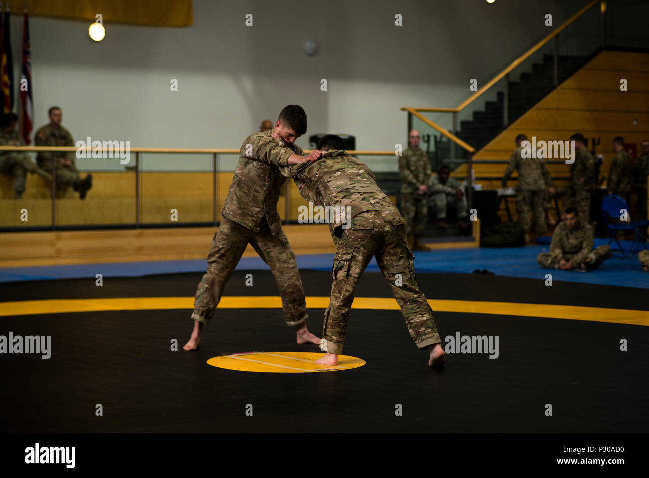 U.S. Army 1st Lt. Kendall Ward (left) with the 173rd Airborne Brigade and 2nd Lt. Justin Ganzer (right) with the 21st Theater Sustainment Command compete in a combatives tournament during the 2016 European Best Warrior Competition held at the 7th Army Training Command's Grafenwoehr Training Area, Germany, Aug. 11, 2016. The intense, grueling annual weeklong competition is the most prestigious competitive event of the region. (U.S. Army photo by Spc. Elliott Banks) - Stock Image