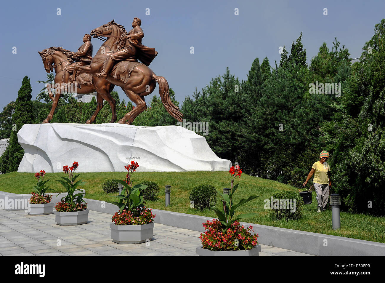Pyongyang, North Korea, bronze figure with Kim Jong-il on the grounds of the Mansudae art studio - Stock Image