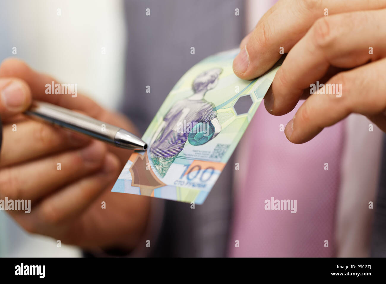 St. Petersburg, Russia - May 23, 2018: General director of JSC Goznak Arkady Trachuk shows the commemorative banknote for FIFA World Cup Russia 2018 e - Stock Image