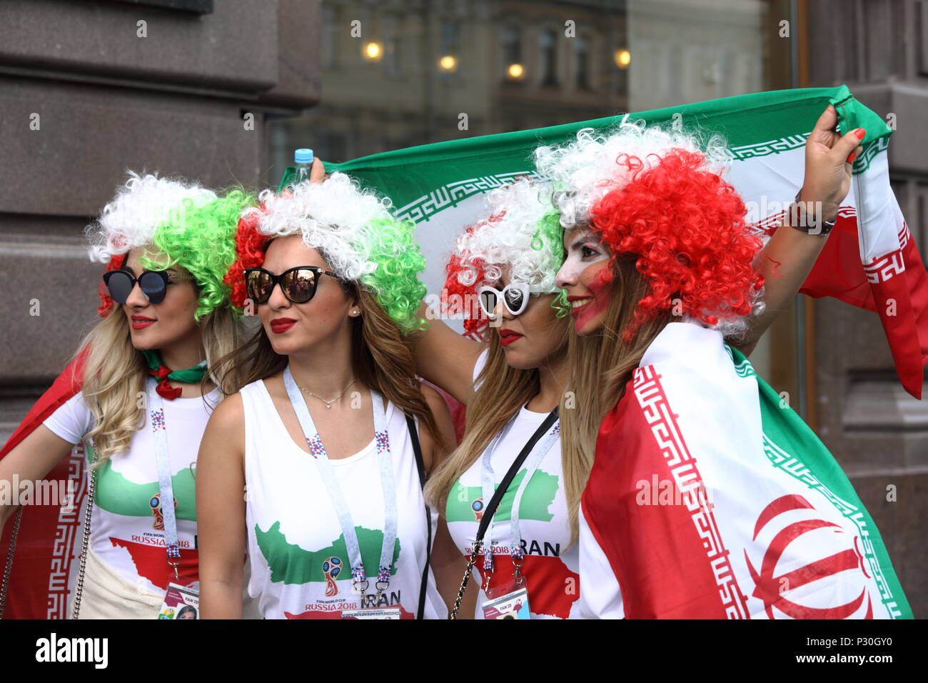 St. Petersburg, Russia - June 15, 2018: Iranian football fans with national flag in Saint Petersburg on the day of first match of FIFA World Cup 2018  - Stock Image