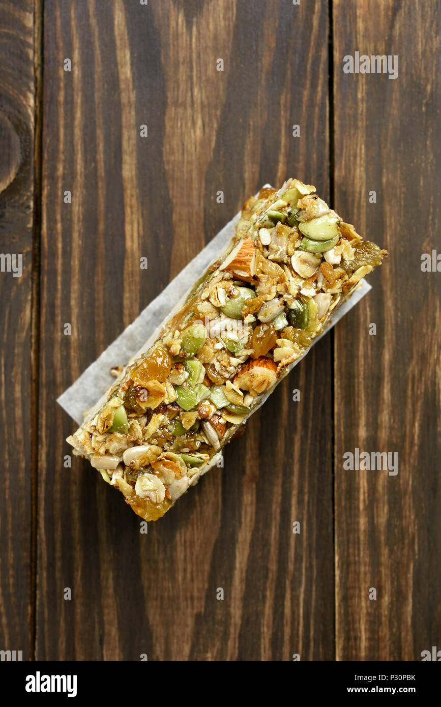 Healthy energy snack granola on wooden background. Top view, flat lay - Stock Image