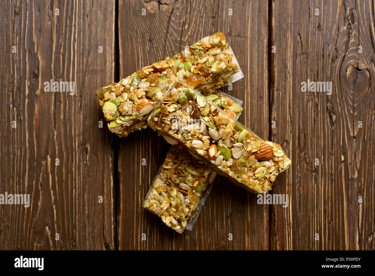 Granola bars on wooden background. Top view, flat lay - Stock Image