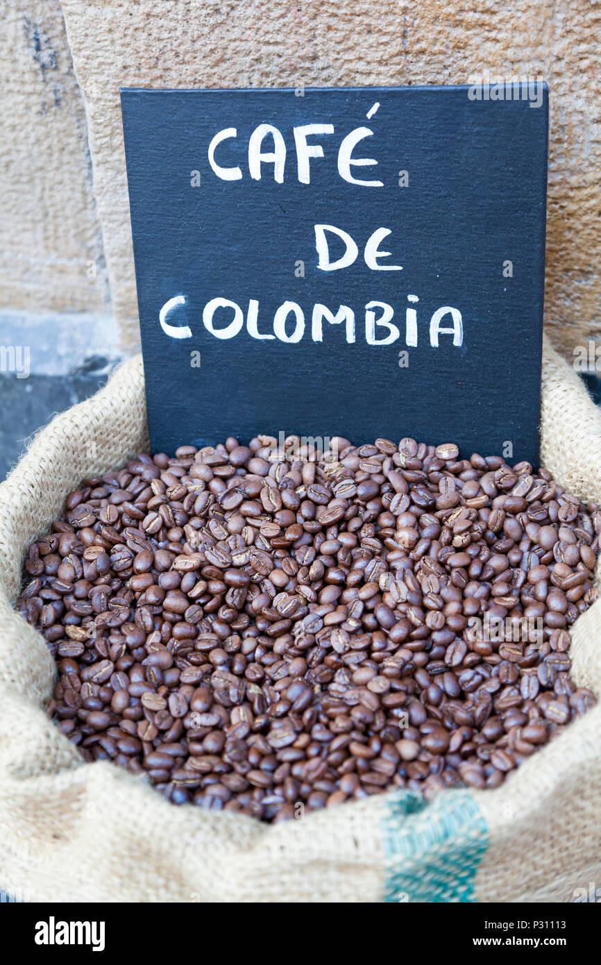 A sack of Columbian coffee beans, Bilbao, Spain. - Stock Image