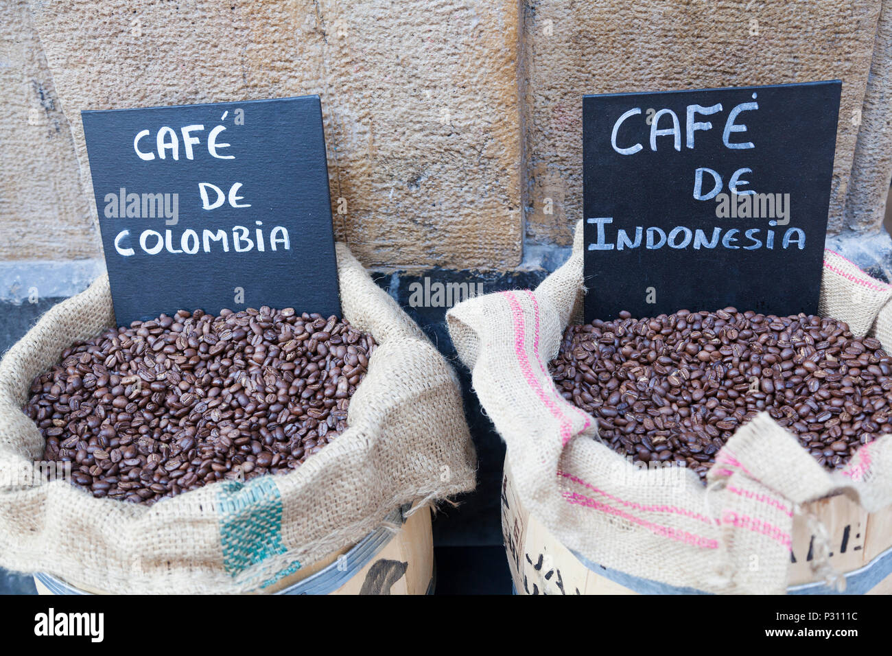 Tow sacks of coffee beans, one Columbian, one Indonesian,  Bilbao, Spain. - Stock Image