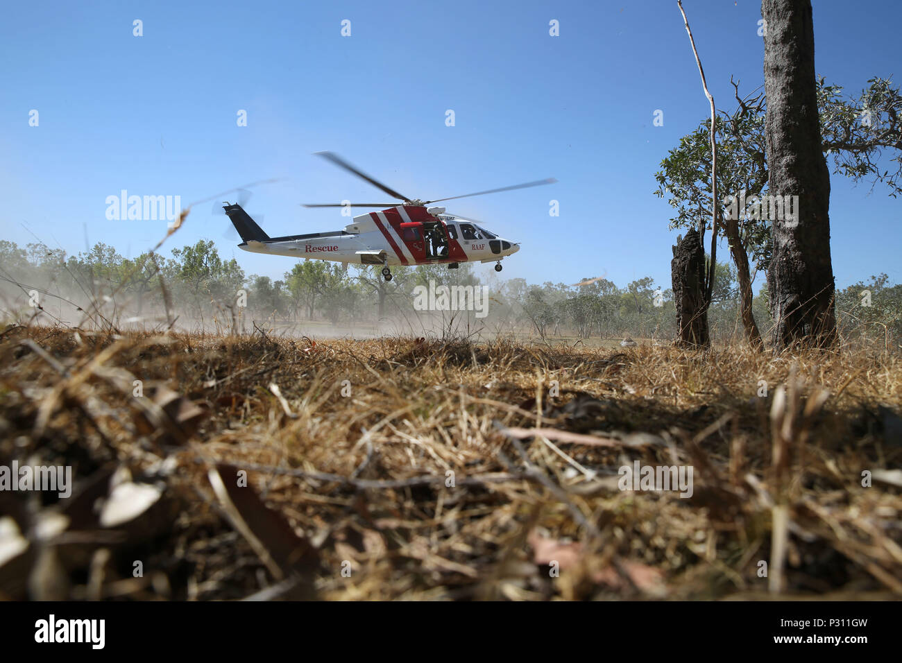 A Sikorsky S76A++ Search and Rescue helicopter hovers during SAR training at Exercise Pitch Black 2016, Royal Australian Air Force Base Tindal, Australia, Aug. 16, 2016. The SAR team trains with local and international forces during exercises like Pitch Black to ensure all medical personnel that can respond to an aircraft emergency are capable of carrying out the same procedures. The biennial, multinational exercise involves approximately 10 allied nations and prepares these forces for possible real-world scenarios. The bilateral effort amongst Exercise Pitch Black 2016 furthermore showcases t - Stock Image