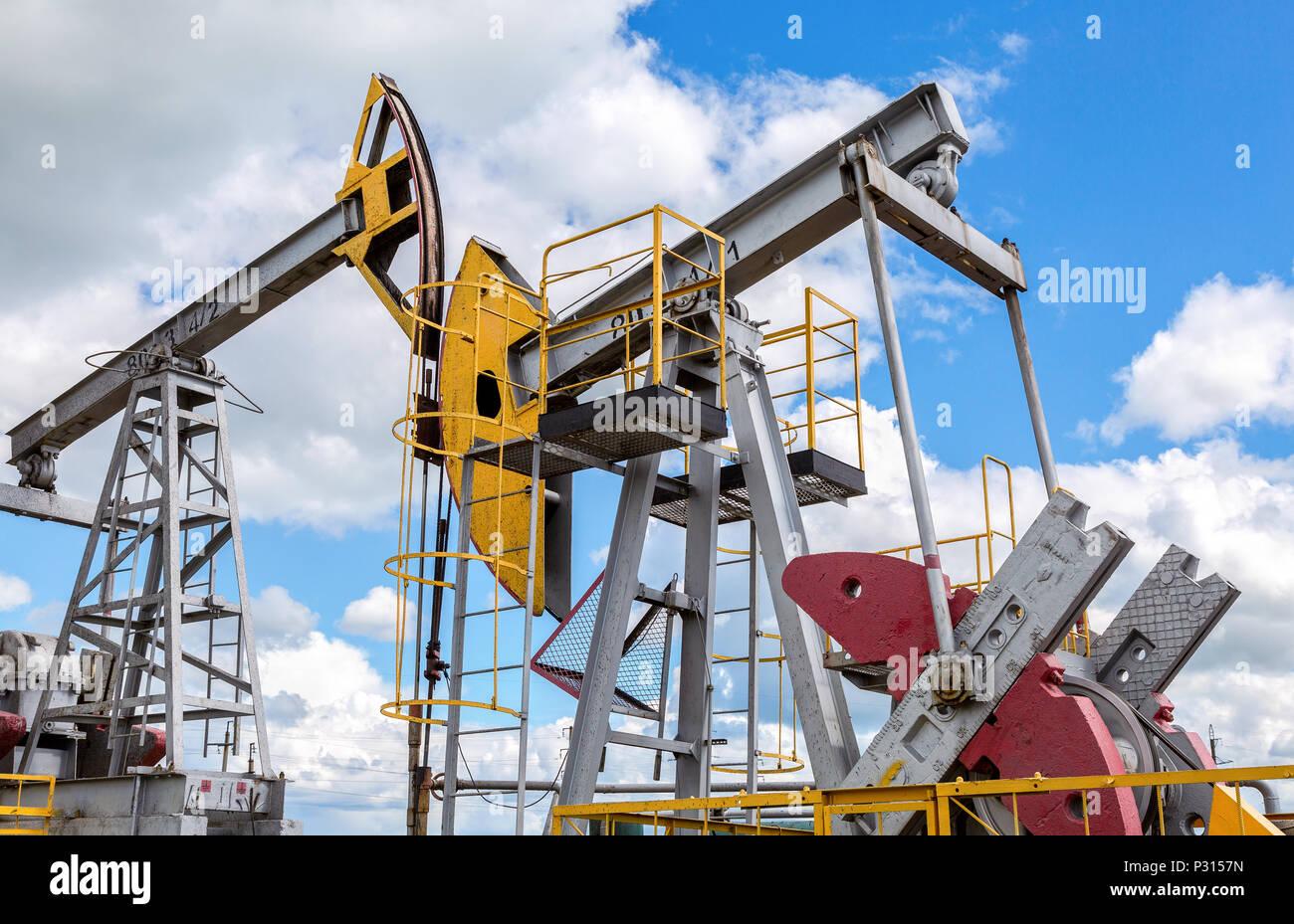 Tatarstan, Russia - June 10, 2018: Working pump jack fracking crude extraction machine. Oil industry equipment Stock Photo
