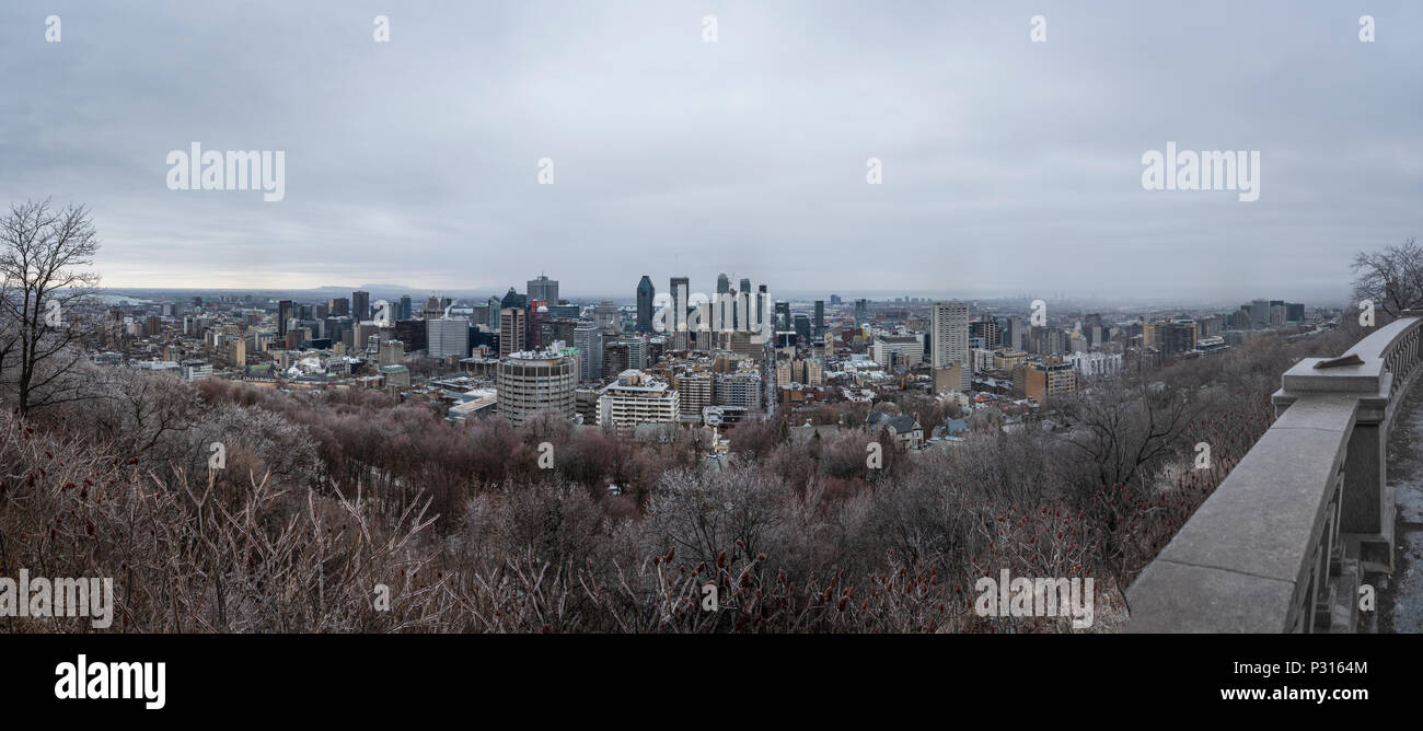Panoramic view of Montreal skyline and cityscape taken from Mont Royal Park, Canada, in Winter on a snowy day - Stock Image