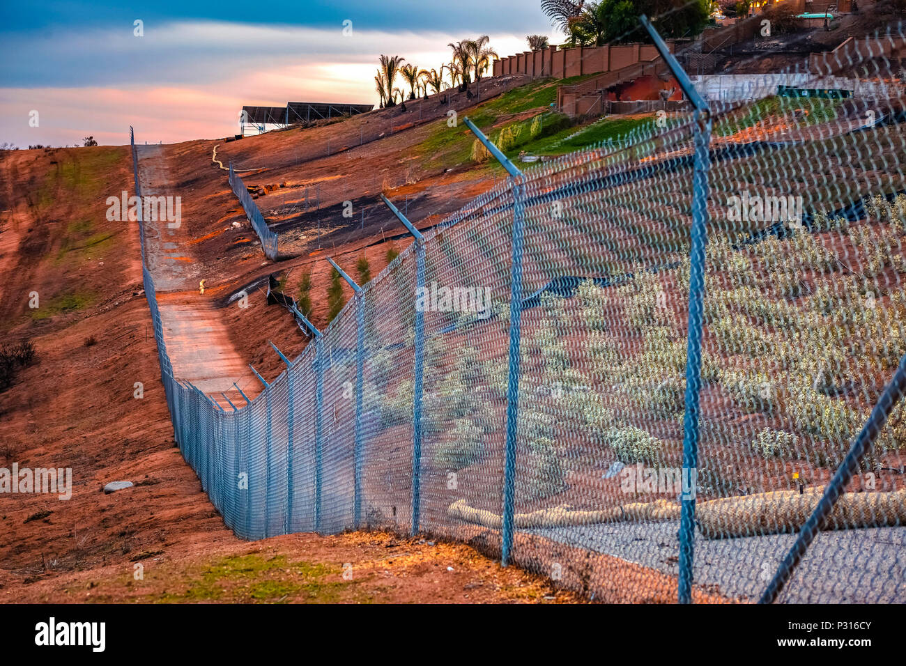 Barbed wire on chain link fence protecting farm in fallbrook