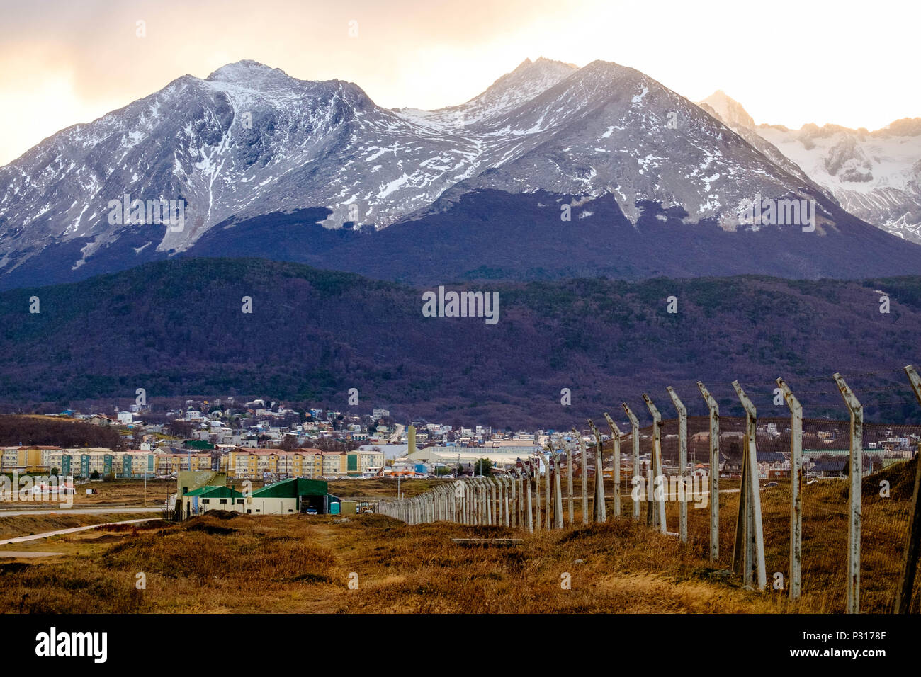 The Martial mountains, with the Martial Glacier at the extreme right, look out over the city of Ushuaia. The forest shows the colors of the autumn. Stock Photo