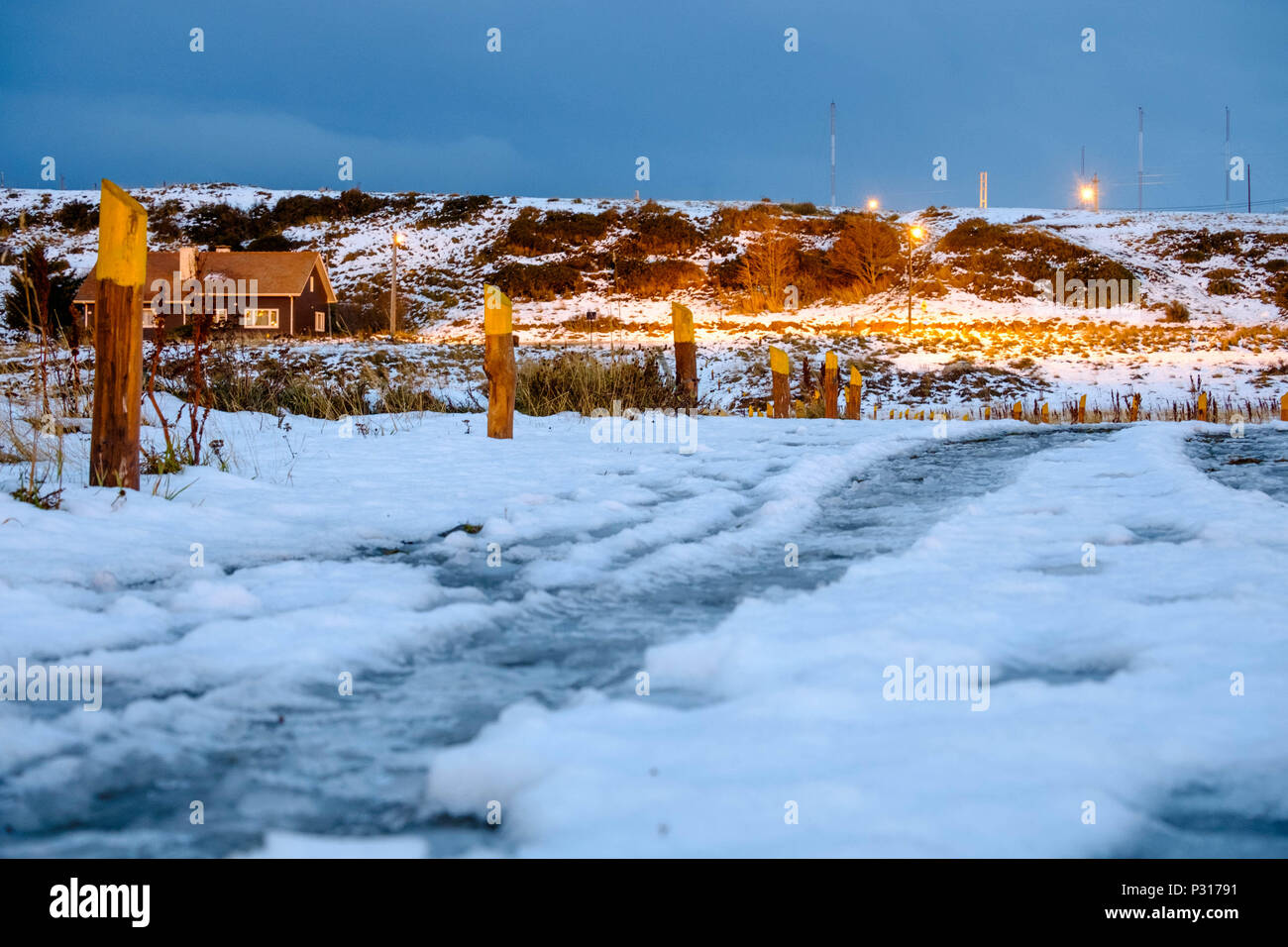 The path next to the 'Bahía Encerrada' in Ushuaia is covered by snow and ice.If it is not too windy, this place is ideal for an evening walk. Stock Photo