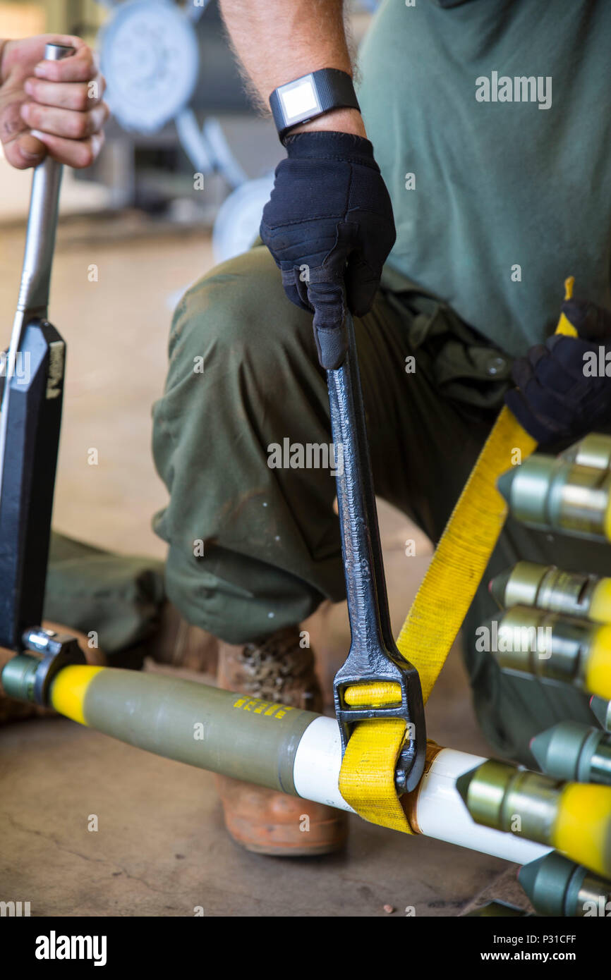 Marine Aviation Logistics Squadron 12 (MALS) Marines tighten a warhead onto a rocket during Southern Frontier at Royal Australian Air Force Base Tindal, Australia, Aug. 23, 2016. These ordnance Marines are working to meet Marine Fighter Attack Squadron (VMFA) 122's goal of dropping 138 tons of ordnance during Southern Frontier. The unit level training afforded Iwakuni Marines the opportunity to train with high explosive weapon body groups typically not used in Japan, while expanding technical and tactical proficiency in their craft. Munitions built during this training are in support of VMFA-1 - Stock Image