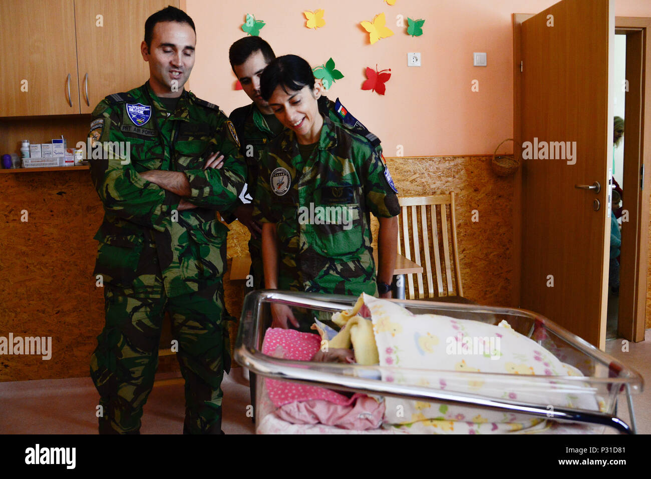 Portuguese airmen greet a baby from kudikiu namai during a portuguese airmen greet a baby from kudikiu namai during a humanitarian civil assistance hca project in sauliai lithuania august 23 2016 m4hsunfo