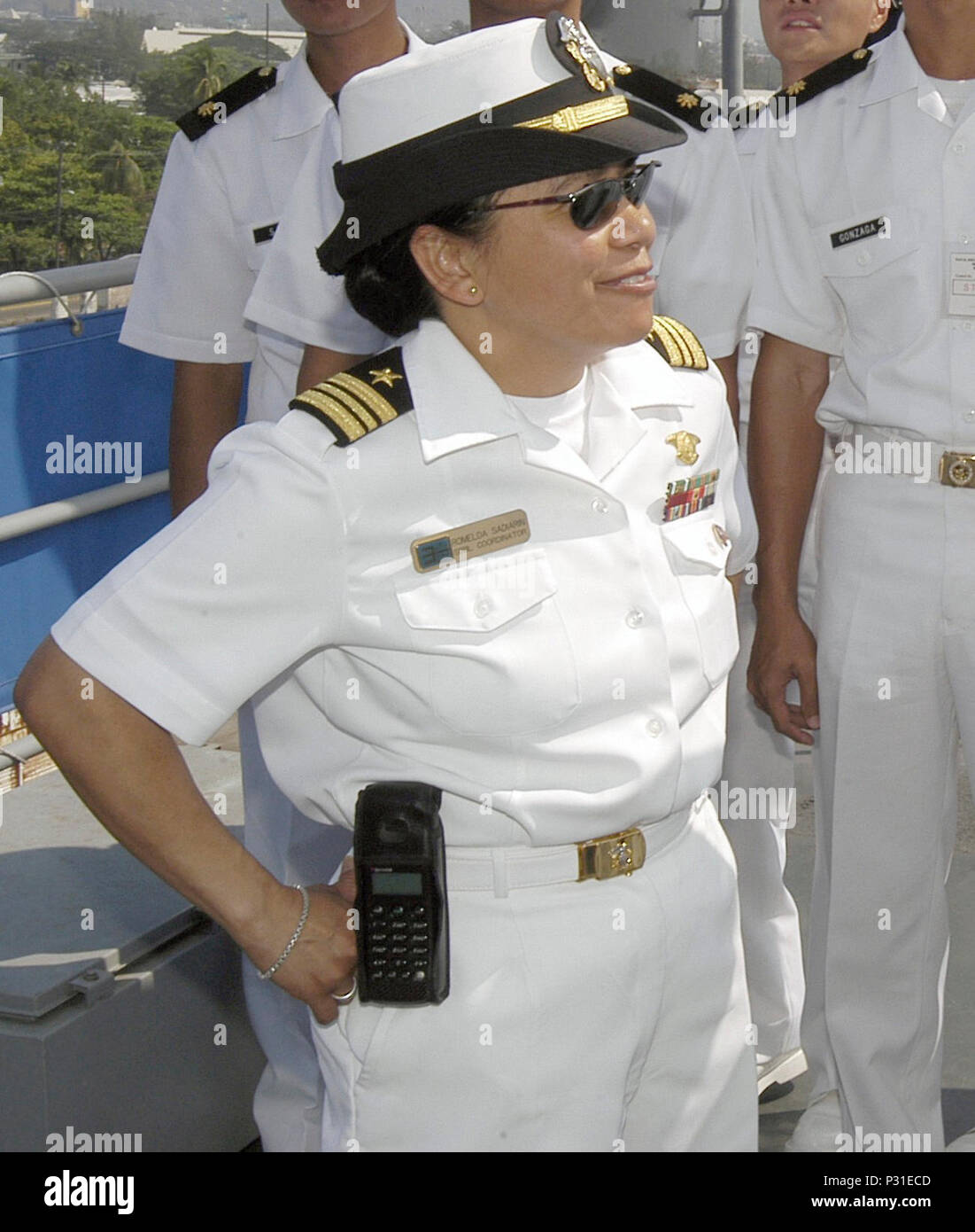 Bay, Republic of the Philippines (Apr. 24, 2004) - Lt. Cmdr. Romelda Sadiarin gives a tour of USS Coronado (AGF 11) to students from the Philippine Navy's Naval Education and Training Command. Coronado arrived for a scheduled port visit. The port visit gives the more than 450 Sailors, civilian mariners and Seventh Fleet staff members embarked aboard Coronado a chance to experience the unique culture of the Philippines, sightsee, and participate in community service projects.  The ship is serving as the temporary command ship for Stock Photo