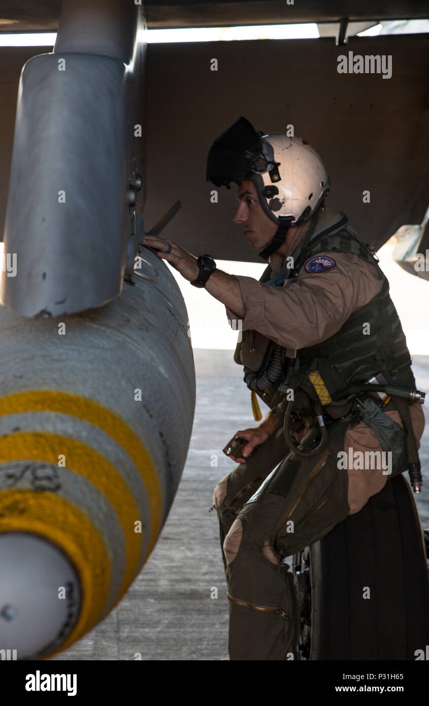 U.S. Marine Corps Maj. David Dunsworth, an F/A-18C Hornet pilot with Marine Fighter Attack Squadron (VMFA) 122, checks ordnance mounted on an aircraft check during Southern Frontier at Royal Australian Air Force Base Tindal, Australia, Aug. 24, 2016. VMFA-122 dropped ordnance during close air support missions to reinforce ground units at Bradshaw Range Complex. Southern Frontier is a three week unit level training evolution helping the flying squadron gain qualifications and experience in low altitude, air ground, high explosive ordnance delivery. (U.S. Marine Corps photo by Cpl. Nicole Zurbru - Stock Image