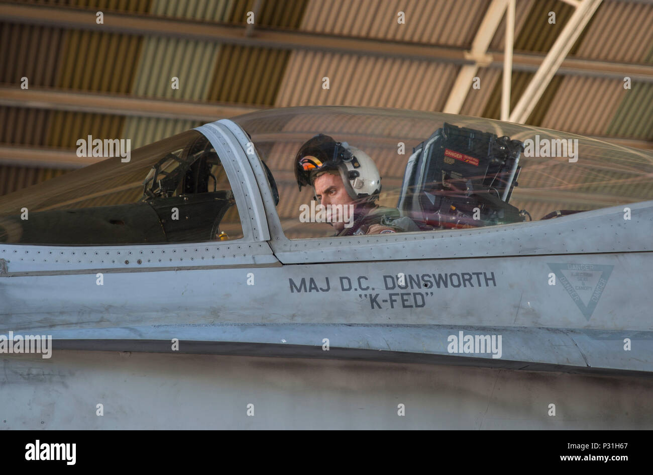 U.S. Marine Corps Maj. David Dunsworth, an F/A-18C Hornet pilot with Marine Fighter Attack Squadron (VMFA) 122, prepares to taxi out of a hangar during Southern Frontier at Royal Australian Air Force Base Tindal, Australia, Aug. 24, 2016. VMFA-122 executed close air support missions for ground combat units conducting exercises at Bradshaw Range Complex. Southern Frontier is a three week unit level training evolution helping the flying squadron gain qualifications and experience in low, air ground, high explosive ordnance delivery. (U.S. Marine Corps photo by Cpl. Nicole Zurbrugg) - Stock Image