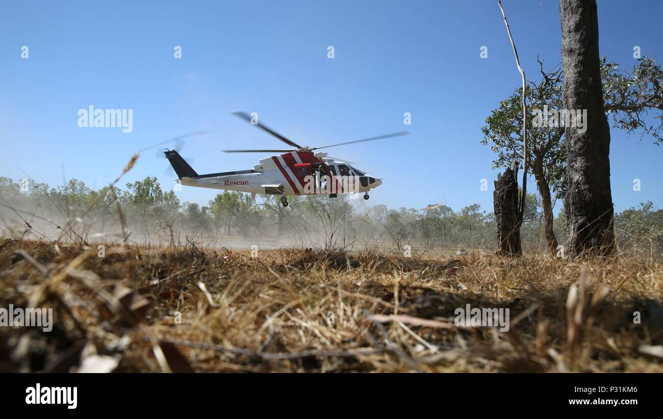 A Sikorsky S76A Search and Rescue helicopter hovers during SAR training at Exercise Pitch Black 2016, Royal Australian Air Force Base Tindal, Australia, August 16, 2016. The SAR team trains with local and international forces during exercises like Pitch Black to ensure all medical personnel that can respond to an aircraft emergency are capable of carrying out the same procedures. The biennial, multinational exercise involves approximately 10 allied nations and prepares these forces for possible real-world scenarios. The bilateral effort amongst Exercise Pitch Black 2016 furthermore showcases t - Stock Image