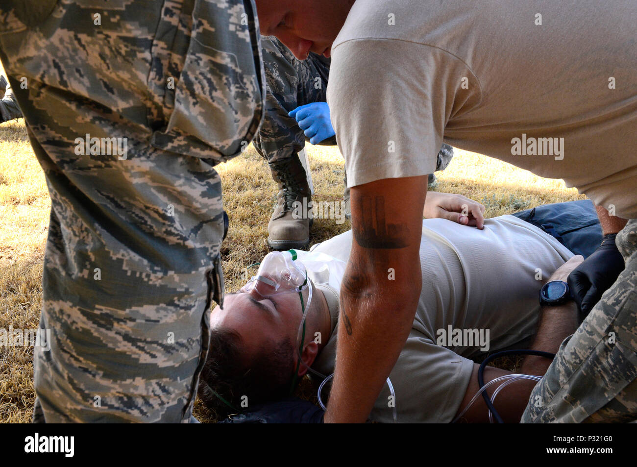Emergency medical technicians assigned to Minot Air Force Base, N.D., treat a patient in a simulated hyperthermia scenario during the 2016 EMT Rodeo Aug. 26, 2016 at Cannon Air Force Base, N.M. Cannon's EMT Rodeo tests the skills of medical professionals from across the Air Force through a series of innovative, high-pressure scenarios. (U.S. Air Force photo by Tech. Sgt. Manuel J. Martinez) - Stock Image