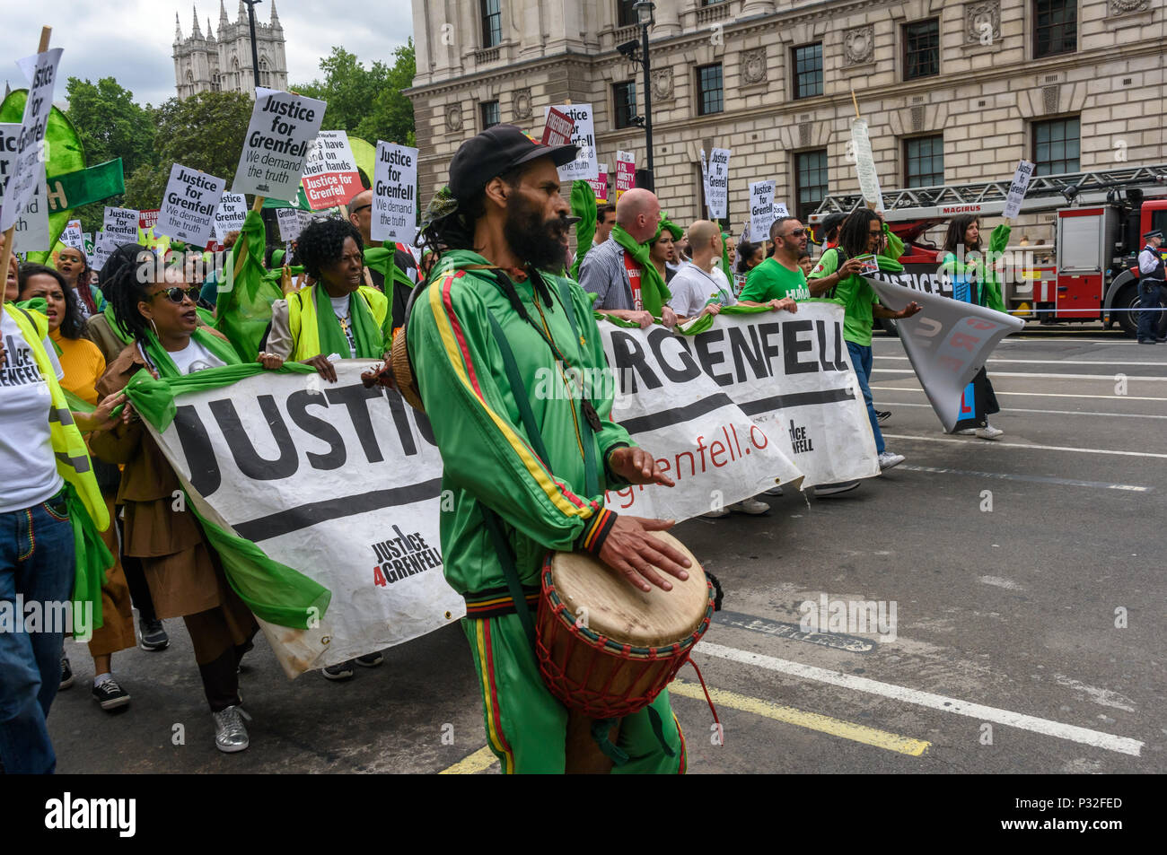London, UK. 16th June 2018. A large crowd at Downing St shows solidarity with the 72 killed and the survivors of the Grenfell fire a year ago at a protest organised by Justice4Grenfell and the FBU (Fire Brigades Union.) After some speeches they marched to the Home Office for a brief protest before returning to Downing St for more speeches. mmodation. 300 tower blocks a Credit: Peter Marshall/Alamy Live News - Stock Image