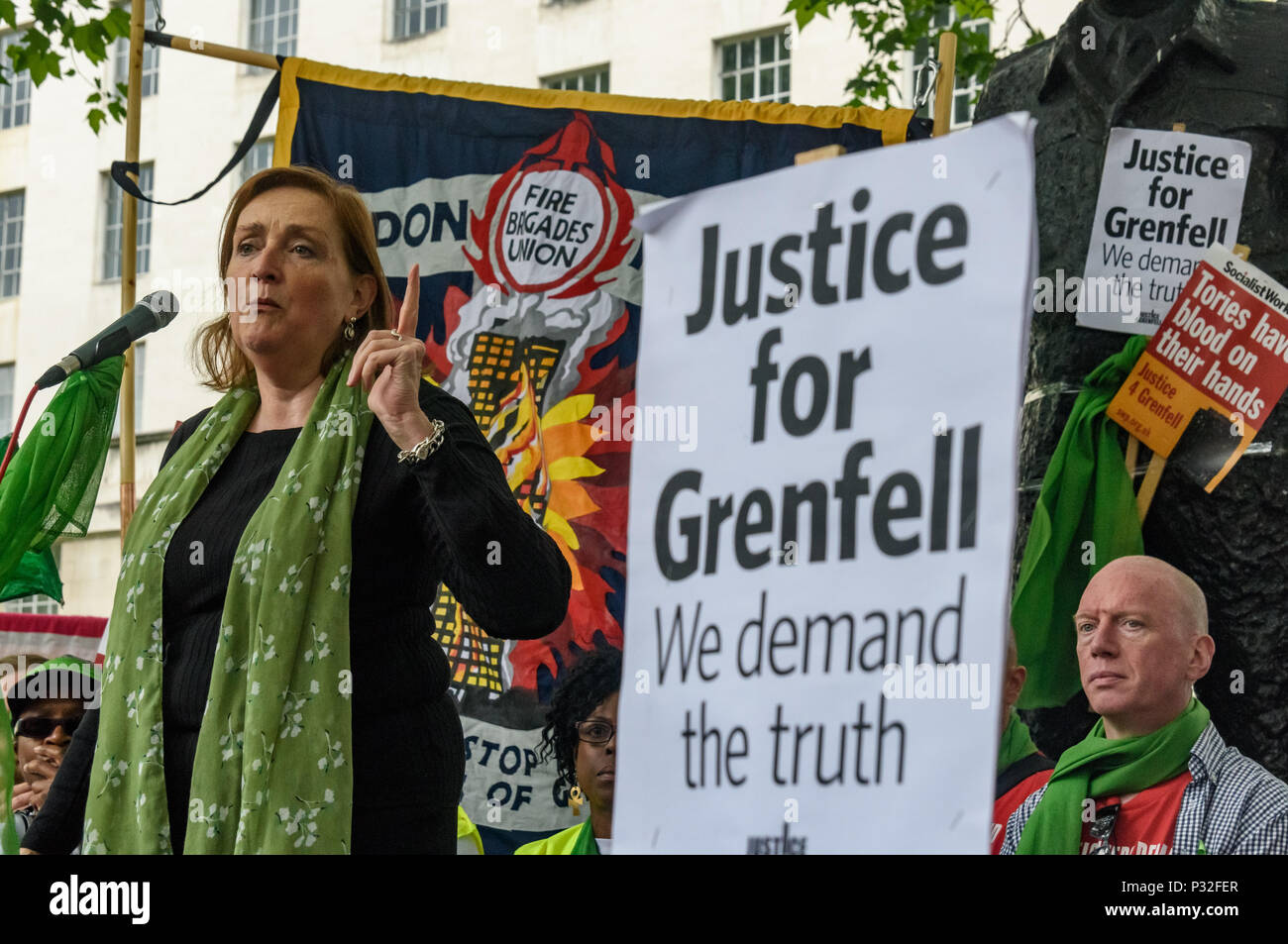 London, UK. 16th June 2018. Kensington Labour MP Emma Dent Coad speaks at the protest at Downing St in solidarity with the 72 killed and the survivors of the Grenfell fire a year ago organised by Justice4Grenfell and the FBU (Fire Brigades Union.) After some speeches they marched to the Home Office for a brief protest before returning to Downing St for more speeches. m Credit: Peter Marshall/Alamy Live News - Stock Image