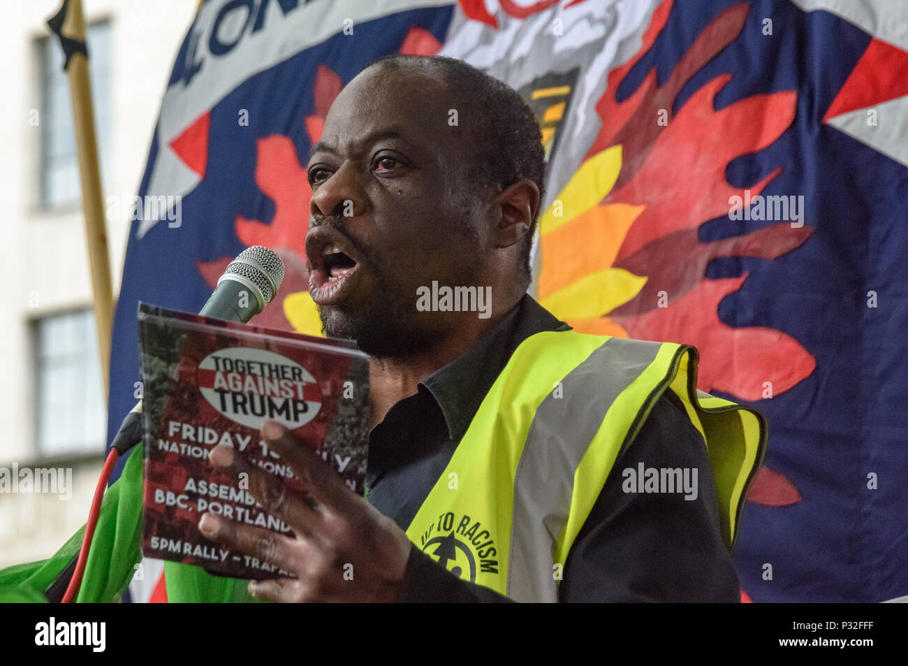 London, UK. 16th June 2018. Weyman Bennett of Stand up to Racism speaks at the protest at Downing St in solidarity with the 72 killed and the survivors of the Grenfell fire a year ago organised by Justice4Grenfell and the FBU (Fire Brigades Union.) After some speeches they marched to the Home Office for a brief protest before returning to Downing St for more speeches. Credit: Peter Marshall/Alamy Live News - Stock Image