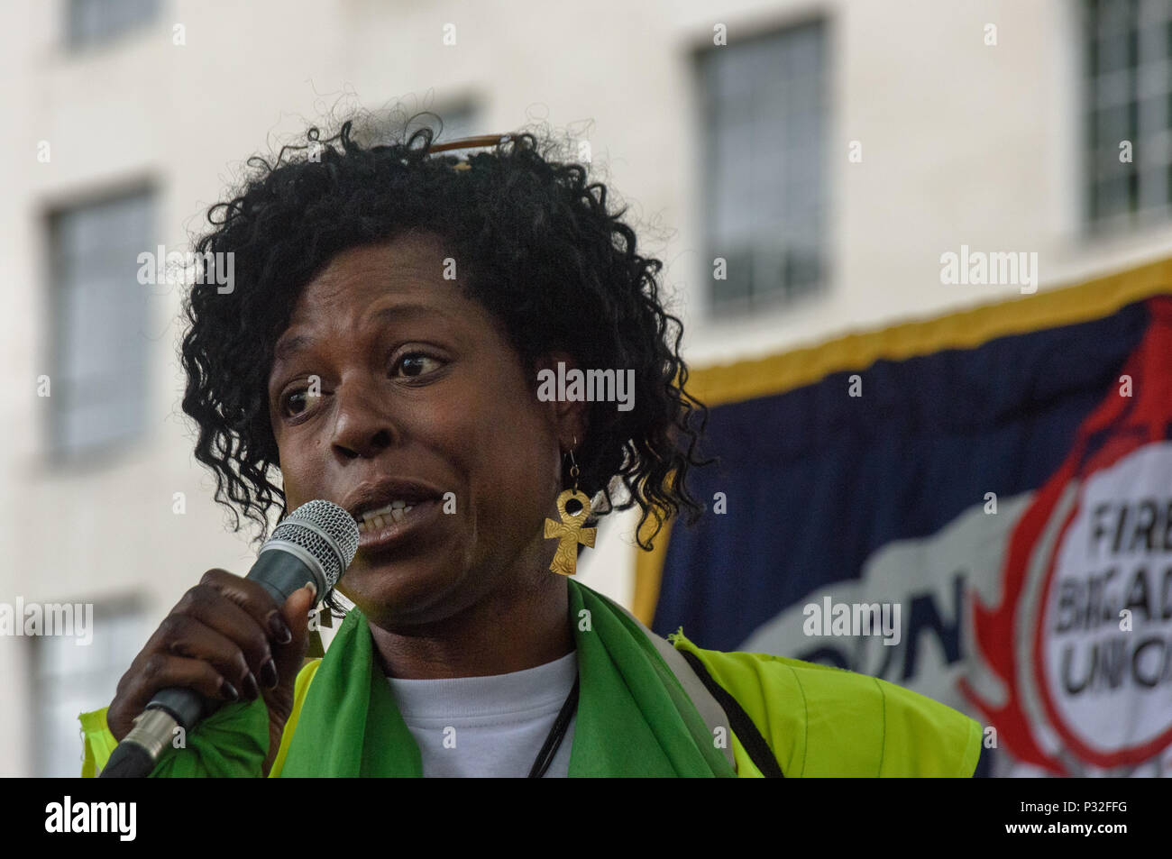 London, UK. 16th June 2018. Yvette Williams from Justice4Grenfell at the protest at Downing St in solidarity with the 72 killed and the survivors of the Grenfell fire a year ago organised by Justice4Grenfell and the FBU (Fire Brigades Union.) After some speeches they marched to the Home Office for a brief protest before returning to Downing St for more speeches. mmodat Credit: Peter Marshall/Alamy Live News - Stock Image