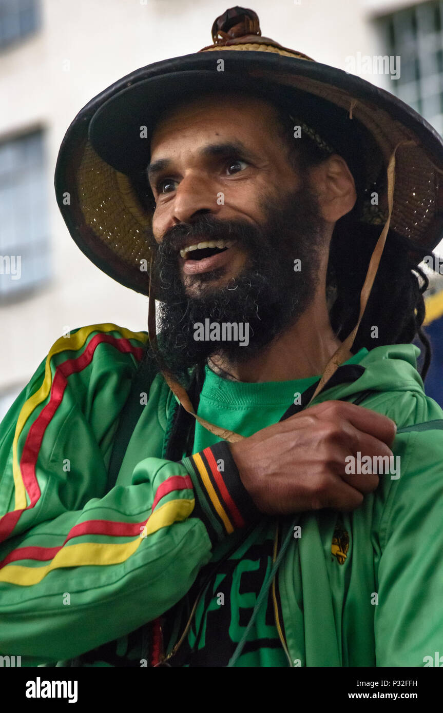 London, UK. 16th June 2018. Notting Hill community organiser Niles Hailstones played drums, sang and spoke at the protest at Downing St in solidarity with the 72 killed and the survivors of the Grenfell fire a year ago organised by Justice4Grenfell and the FBU (Fire Brigades Union.) After some speeches they marched to the Home Office for a brief protest before returning to Downing St for more speeches. Speakers complained of the many promises made by Theresa May which have been broken, despite her promise all survivors would be rehoused in 3 weeks, a year later 50% of survivors and displaced f - Stock Image