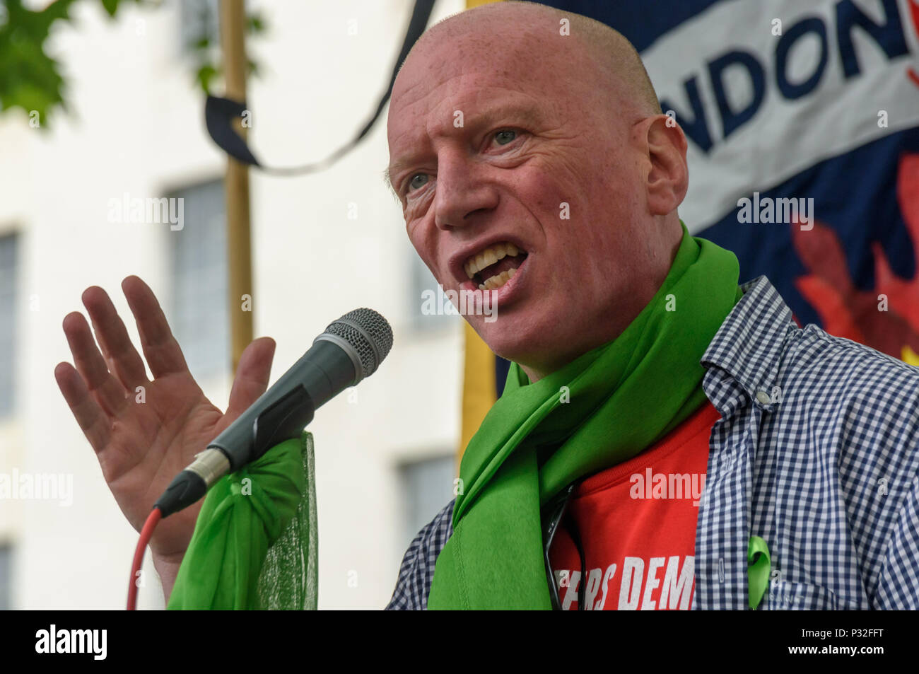 London, UK. 16th June 2018.FBU General Secretary Matt Wrack speaks at the protest at Downing St in solidarity with the 72 killed and the survivors of the Grenfell fire a year ago organised by Justice4Grenfell and the FBU (Fire Brigades Union.) After some speeches they marched to the Home Office for a brief protest before returning to Downing St for more speeches. mmoda Credit: Peter Marshall/Alamy Live News - Stock Image