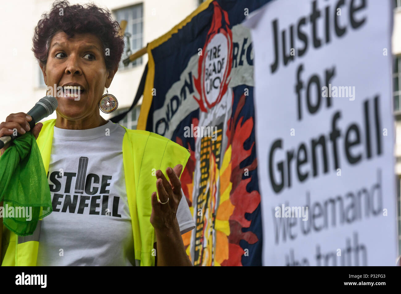 London, UK. 16th June 2018. Moyra Samuels from Justice4Grenfell speaks at the protest at Downing St in solidarity with the 72 killed and the survivors of the Grenfell fire a year ago organised by Justice4Grenfell and the FBU (Fire Brigades Union.) After some speeches they marched to the Home Office for a brief protest before returning to Downing St for more speeches. m Credit: Peter Marshall/Alamy Live News - Stock Image