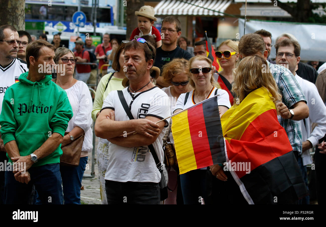 Frankfurt, Germany. 17th June 2018. Right-wing protesters listen to the rally, wearing German national soccer shirts and carrying German flags. Around 50 right-wing protesters followed the call of Heidi Mund, the former organiser of the FRAGIDA protest in Frankfurt, to use the newly styled 'Tag der Patrioten' (Day of the Patriots), to protest against the government and refugees outside the St. Paul's Church in Frankfurt, a symbol for German Democracy. The protest was part of a larger movement of different right-wing organisations to change the former Day of German Unity (17. June) to a Day of  - Stock Image