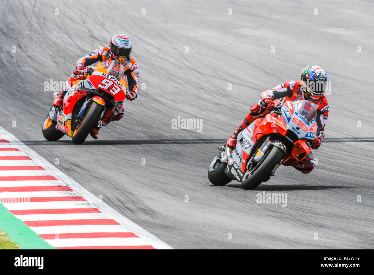f45bca4d71c0d JORGE LORENZO (99) of Spain and MARC MARQUEZ (93) during the MotoGP