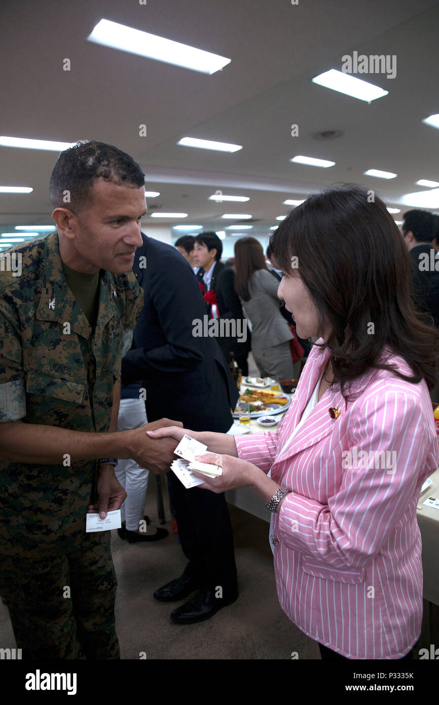 The defense minister of japan tomomi inada right and col david the defense minister of japan tomomi inada right and col david jones exchange business cards during a luncheon aug 28 at the japan self defense force reheart Gallery