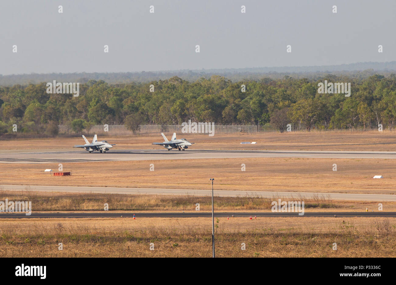 Two F/A-18C Hornets with Marine Fighter Attack Squadron (VMFA) 122 prepare for takeoff during Southern Frontier at Royal Australian Air Force Base Tindal, Australia, Aug. 31, 2016. The Hornet squadron performed low-altitude tactics training throughout the last week of training, allowing the pilots to gain confidence in low flying and simultaneously conducting air-to-surface maneuvers. Southern Frontier is a three week unit level training helping pilots gain experience and qualifications in low-altitude tactics, close air support, and air ground, high explosive ordnance delivery. (U.S. Marine C - Stock Image