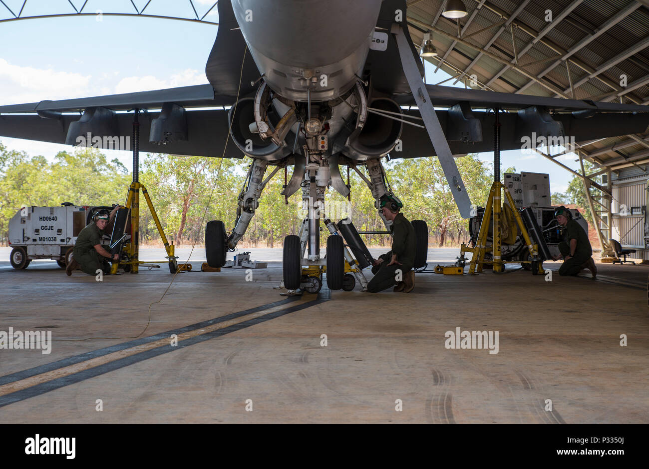 U.S. Marines assigned to Marine Fighter Attack Squadron (VMFA) 122 prepare to lower an F/A-18C Hornet during Southern Frontier at Royal Australian Air Force Base Tindal, Australia, Aug. 31, 2016. In preparation for departure from Australia, the squadron performs maintenance on all aircraft to ensure they are ready to make the long flight home. Southern Frontier is a three week unit level training that helps pilots gain experience and qualifications in low-altitude tactics, close air support, and air ground, high explosive ordnance delivery. (U.S. Marine Corps photo by Cpl. Nicole Zurbrugg) - Stock Image
