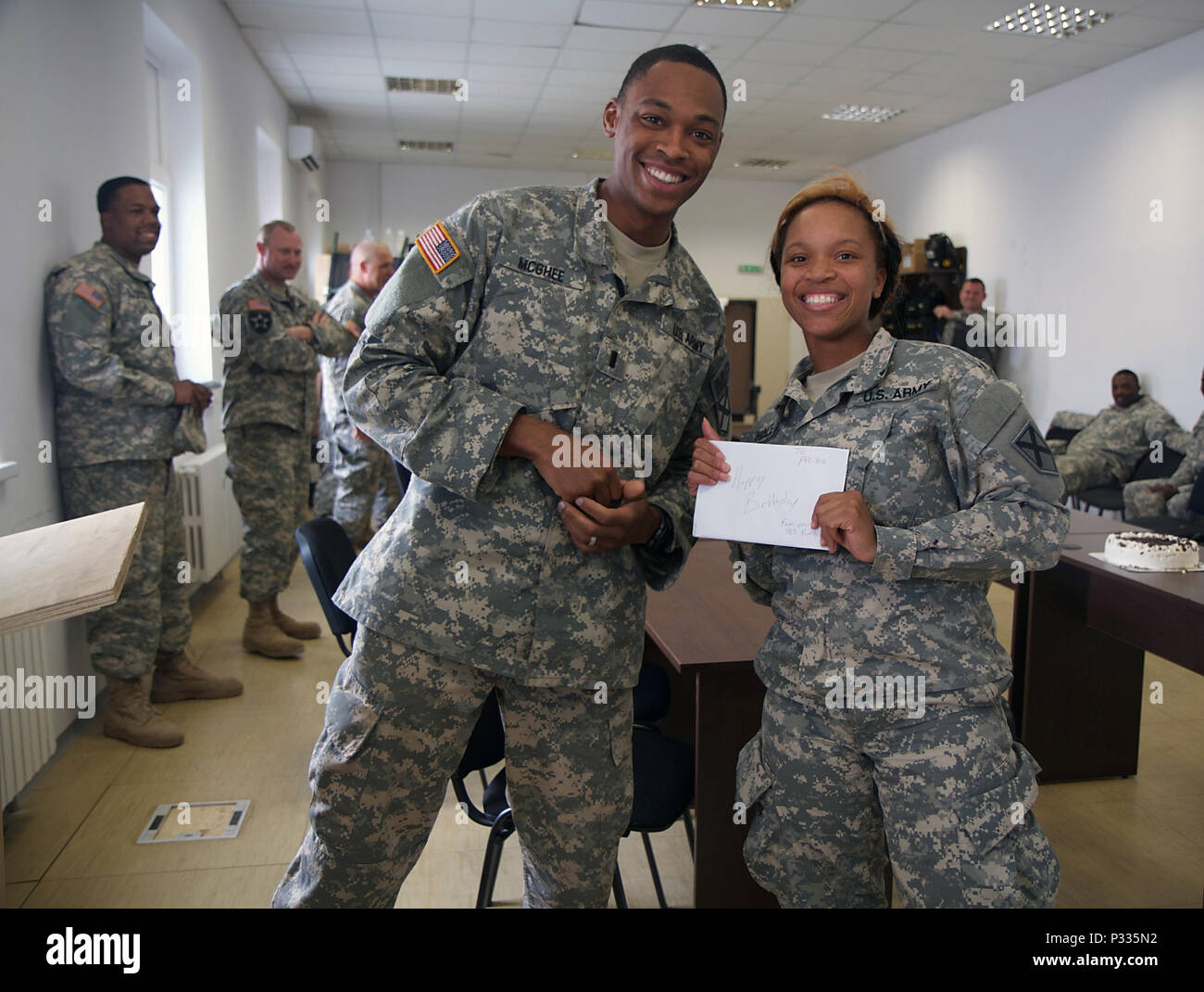 1st Lt Jeremy Mcghee 226th Manuver Enhancement Brigade Stands With Pfc Lakenya Hale 1165th Military Police Company During Her 19th Birthday Celebration At The Cincu Training Center Romania U S Army National Guard