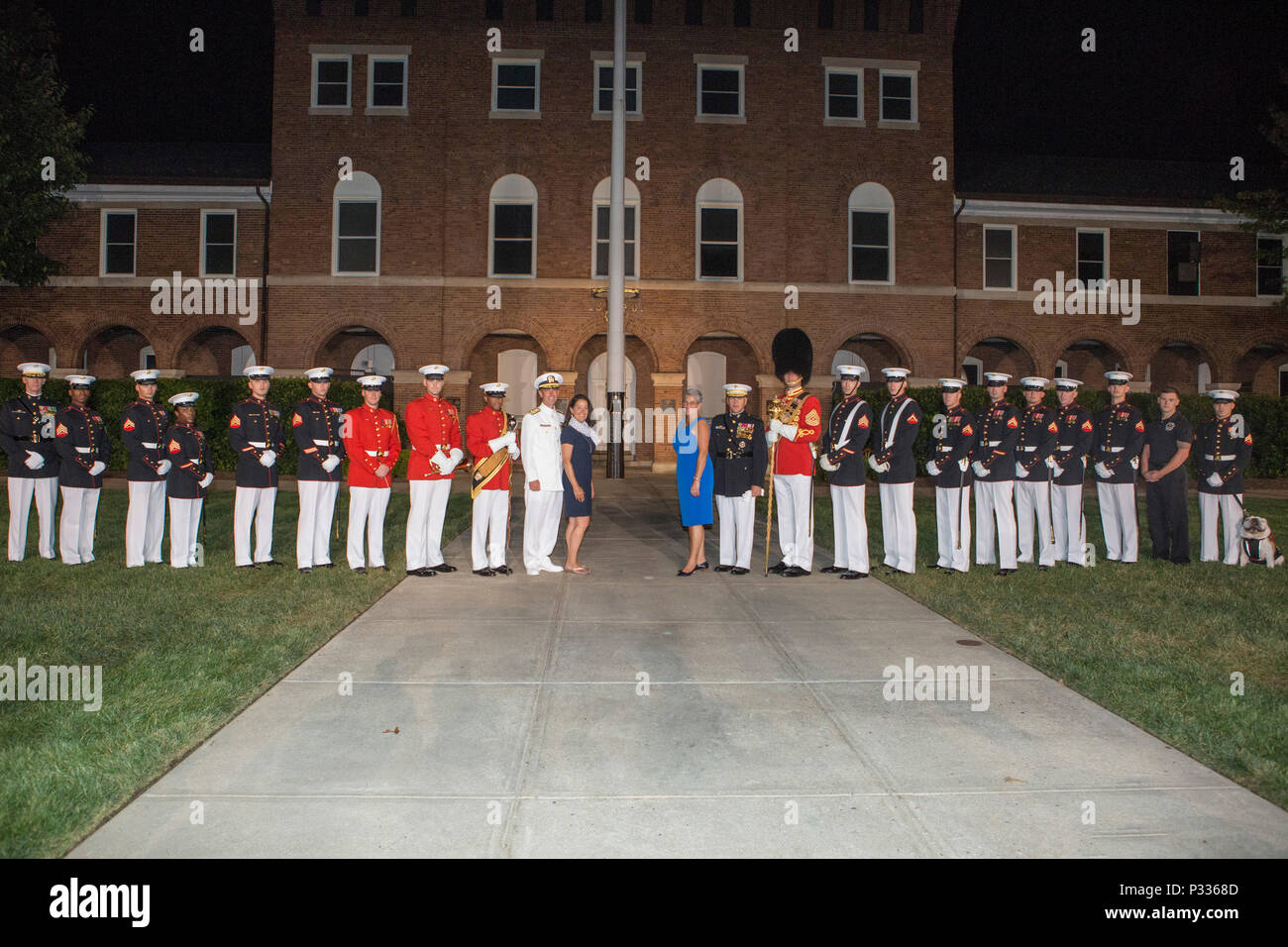 Chief of Naval Operations Adm. John M. Richardson and his wife, Dana Richardson, center left, pose for a photo with the Commandant of the Marine Corps Gen. Robert B. Neller, his wife, D'arcy Neller, and Marines from Marine Barracks Washington after the evening parade at Marine Barracks Washington, Washington D.C., Aug. 19, 2016. Evening parades are held as a means of honoring senior officials, distinguished citizens and supporters of the Marine Corps. (U.S. Marine Corps photo by Lance Cpl. Stephon L. McRae) Stock Photo