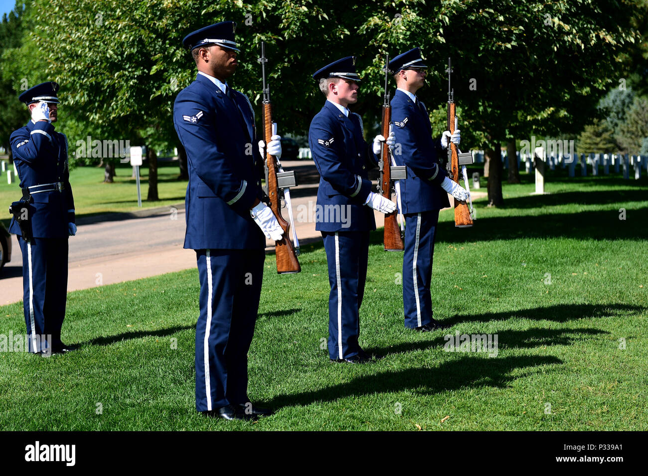 U.S. Air Force Mile High Honor Guard members finish a three volley rifle salute during a funeral August 30, 2016, at Fort Logan National Cemetery, Colo. The three volleys originally indicated that casualties had been cared for during combat, but over time they have become known as honoring the fallen. (U.S. Air Force photo by Airman 1st Class Gabrielle Spradling/Released) - Stock Image