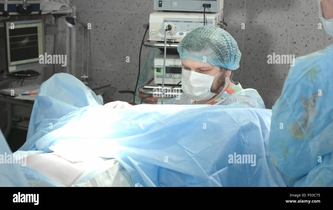 Medical team performing operation in hospital Stock Photo