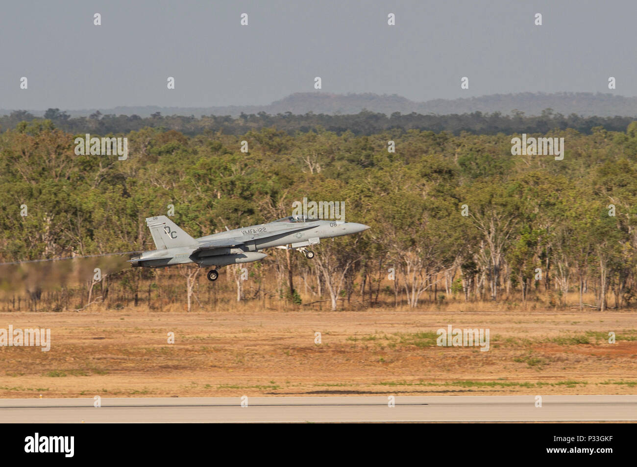 An F/A-18C Hornet with Marine Fighter Attack Squadron (VMFA) 122 takes off during Southern Frontier at Royal Australian Air Force Base Tindal, Australia, Aug. 31, 2016. VMFA-122 executed low-altitude tactics training, flying below 500 feet to evade simulated enemy radar detection or to escape enemy aircraft vectored toward friendly aircraft. By integrating low-altitude tactics into the three week unit level training, pilots gained their final qualifications during Southern Frontier, strengthening the squadrons overall combat readiness. (U.S. Marine Corps photo by Cpl. Nicole Zurbrugg) - Stock Image