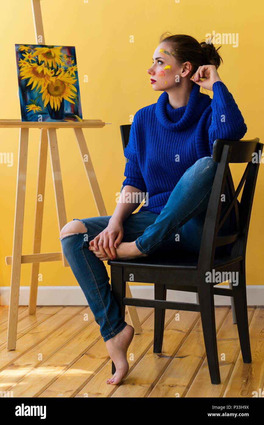 Enjoyable Girl Artist Sitting On Chair In Sweater And Jeans She Is Interior Design Ideas Lukepblogthenellocom